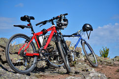 Mountain bikes in countryside. Two mountain bikes standing in countryside Stock Photos