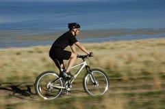 Mountain biking. Blur / action shot of mountain biker Stock Photos