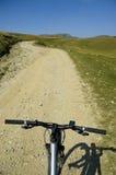 Mountain biking. Bicycle on a path in Bucegi Mountain, Romania Stock Photography