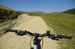 Mountain biking. Bicycle on a path in Bucegi Mountain, Romania stock photos