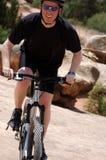 Mountain biking. Happy mountain biker in Moab, UT Royalty Free Stock Photography