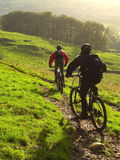 Mountain Biking in Autumn. Male and Female mountain biking in the Yorkshire Dales, UK Stock Photo