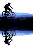 Mountain Biking on Bank of Lake Stock Photos