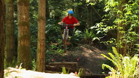 Mountain Biking. A mountain biker going over jumps at a public bike park near Seattle, version 8