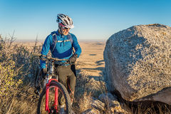 Mountain biking in Colorado foothills. Senior male with a mountain bike in Colorado foothills, Soapstone Prairie Natural Area near Fort Collins stock image