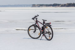 Mountain biking company Giant ice of the Siberian river Ob Stock Images
