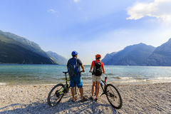 Mountain biking couple on Lake Garda. stock photography
