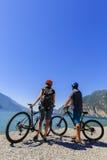 Mountain biking couple on Lake Garda. Stock Photos
