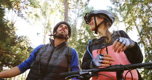 Mountain biking couple pointing at nature