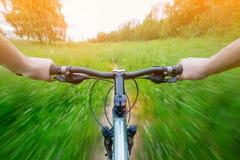 Mountain biking down hill descending on bicycle. Stock Photos