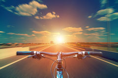 Mountain biking down hill descending fast on bicycle. View from. Bikers eyes Royalty Free Stock Photo