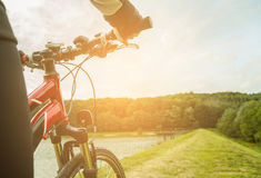 Mountain biking down hill descending fast. View from bikers eyes Stock Image