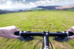 Mountain biking down the trail Royalty Free Stock Photography