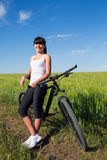 Mountain biking happy sportive girl relax in meadows sunny countryside Royalty Free Stock Images
