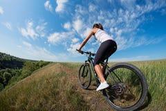 Mountain biking happy sportive girl relax in meadows sunny countryside Royalty Free Stock Photos