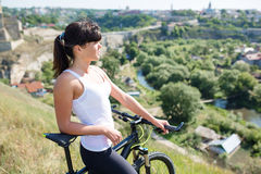 Mountain biking happy sportive girl relax in meadows sunny countryside Royalty Free Stock Photography