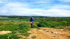 Mountain biking through historical valley Stock Image