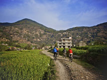 Mountain biking in Nepal. Stock Photo