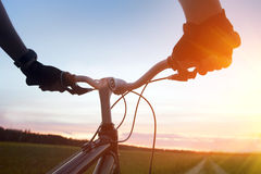 Mountain biking. And a sunset royalty free stock photo