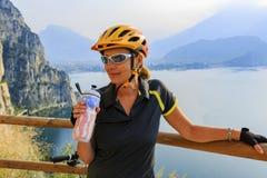 Mountain biking woman drinking water. stock photo