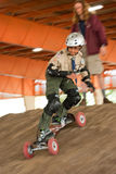 Mountain Boarding. A Boys Scout heads down the dirt at the Mountain Boarding station at the Northern California 100th Anniversary Jamboree.  The event at the Royalty Free Stock Photo