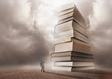 Mountain of Books. A man looking forwards a mountain of books Stock Image