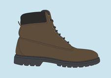 Mountain Boot. Brown leather boot for mountain, with seams and other details. Sole in grey rubber and brown laces Stock Image