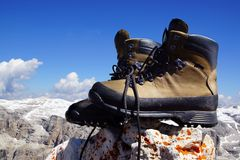 Mountain boots. The background of the mountain landscape Royalty Free Stock Photos