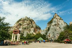 The mountain and bridge are at Khao Ngoo rock park. royalty free stock image
