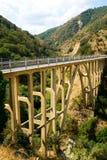 Mountain bridge over the river. Mountain road bridge over the river in italy Royalty Free Stock Photography