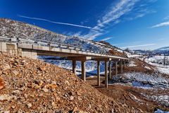 Mountain bridge in winter with snow and blue sky Royalty Free Stock Photos