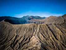 Mountain Bromo active volcano crater in East Jawa, Indonesia. Top view from drone fly Royalty Free Stock Photos