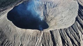 Mountain Bromo Active Volcano Crater In East Jawa, Indonesia. Top View From Drone Fly. 4K Footage Stock Photo
