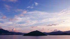 Mountain, building, dramatic sky and sea at sunset Stock Photos