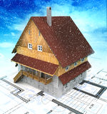 Mountain building house with layout plan at cloudy snowfall Royalty Free Stock Image