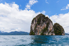 Mountain in bule lagoon and sky Royalty Free Stock Photography