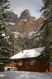 Mountain cabin. Log mountain cabin with a eak in background Royalty Free Stock Photography