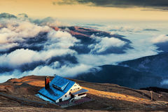 Mountain cabin above clouds Stock Image