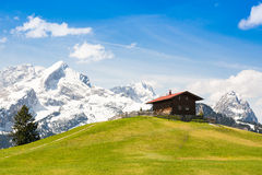 Mountain cabin in alps Stock Images