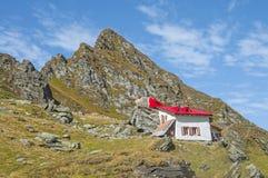 Mountain cabin in Carpathians mountains Stock Image