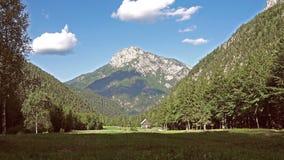 Mountain cabin in European Alps, Robanov kot, Slovenia stock footage