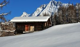 Mountain cabin with fresh snow Stock Photos