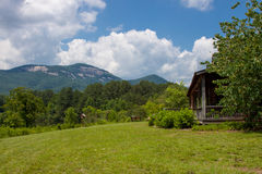 Mountain cabin. Landscape of a Cabin in a field with Blue Ridge mountains in the background Royalty Free Stock Photo