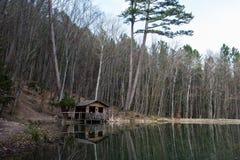 Mountain cabin in reflection Stock Photos