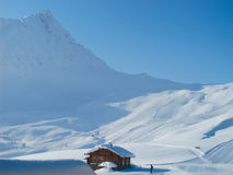 Mountain cabin on ski slopes. Mountain cabin on sunny day. Extensive powder snow. French alps Stock Photography