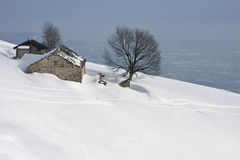 Mountain cabin in the snow Stock Images