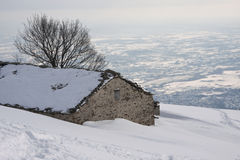 Mountain cabin in the snow Royalty Free Stock Image