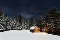 Mountain cabin in winter Royalty Free Stock Images