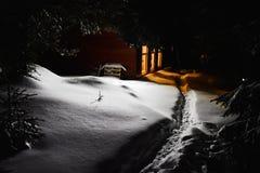 Mountain cabin in winter evening scene. Mountain lodge in winter evening scene Stock Images