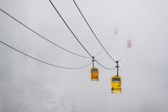 Mountain cable car in mist Royalty Free Stock Image